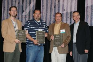 (L-R) John Cunningham, Iowa Concrete Paving Association; Andy Denker, Concrete Technologies, Inc.; David Clark, Wicks Construction, Inc.; and Gerald F. Voigt, American Concrete Pavement Association, take time for a photograph after the award was presented.