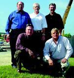 The Speed Fab-Crete management team includes (standing from left) Carl Hall, Jeff Spedding, David Bloxom, (in front) Ron Hamm, and Jim Barton.