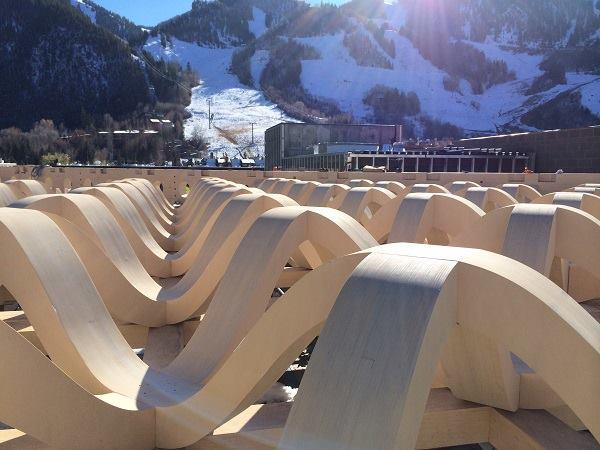 A view of the Aspen Art Museum's roof trusses. These wavy forms, which do not require metal joints, will support the roof and partially shelter the rooftop garden, where museum attendees can take in public programming (such as film screenings) as well as ski runs in the distance.