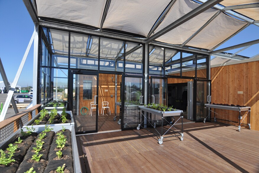 University at Buffalo, The State University of New York presents GRoWHome, a 770-square-foot one bedroom house for an urban gardening couple that includes a 320-square-foot greenhouse capable of producing year-round vegetable growth.