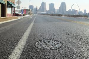 Utility crews use adjustable risers after repaving to keep potholes from forming when St. Louis' 200,000 water and sewer manholes are below grade. As a result, snowplow operators don't have to worry about catching the rims.