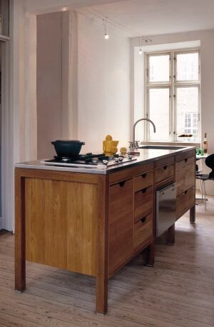 Designed by architect Knud Kapper for Denmark-based Hansen Living, Living Kitchen Architecture is an eco-friendly collection of solid wood cabinets and islands. Each piece is made from plantation-grown Danish hardwoods with mortise and tenon joints and pl