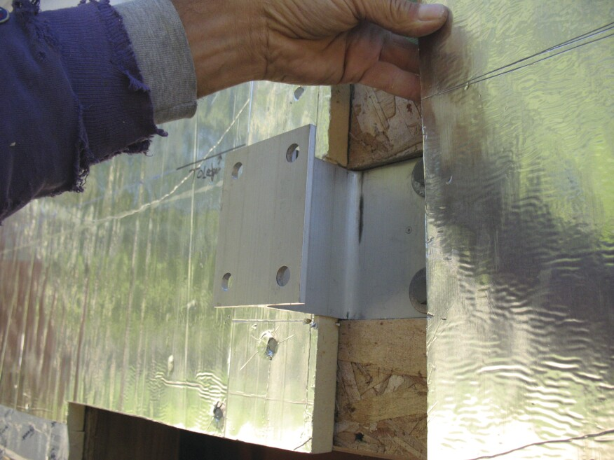 The foam panel is cut to fit around the bracket web. The brackets can accommodate foam up to 3 inches thick.