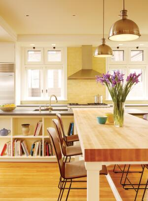 An intersecting butcher block slab extends into the public area as a counter-height table.