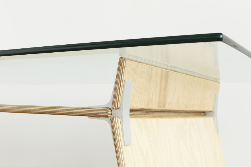 A detail of a wood-and-glass desk designed by New Lab member EcoSystems Brand from its new line, Modos.