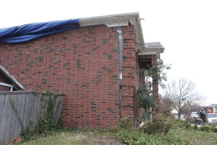 Failure of brick veneer exposed to relatively moderate wind speeds was common on the fringes of the tornado's track.
