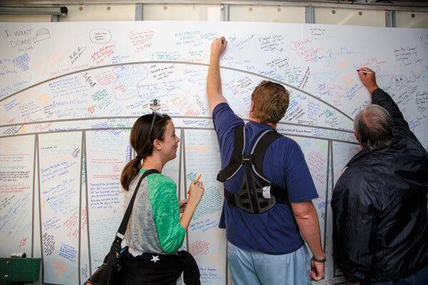 "Visitors showed their support for saving the Astrodome by signing their names inside the ""Dome-Mobile,"" rented by the group Preservation Houston during the firesale."