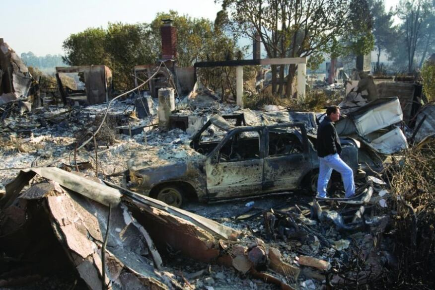 Too hot to handle: Homeowner Jay Gray surveys the destruction to his Rancho Bernardo, Calif., home after fires swept through his neighborhood in October 2007. Few local production builders have had much success participating in the rebuilding efforts.