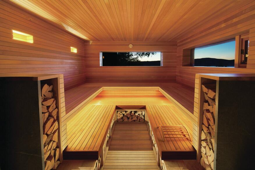 The sauna's interior is lined with cedar slats.