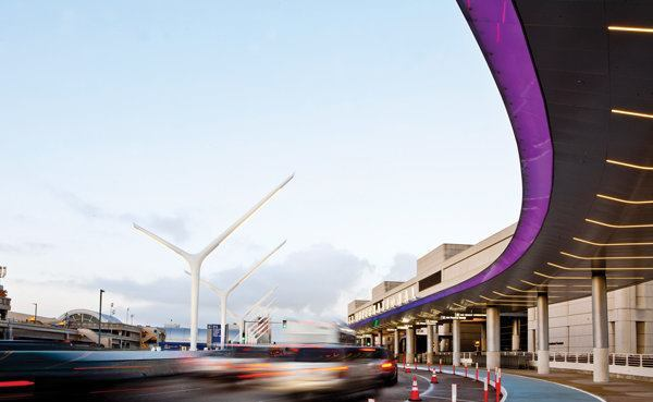 The arrivals level of Tom Bradley International Terminal features a new 800-foot-long canopy, with a light ribbon at its edge synced to change colors with the gateway entry pylons.