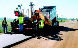 Road crews place hot-mix asphalt over the stabilized, recycled subgrade.