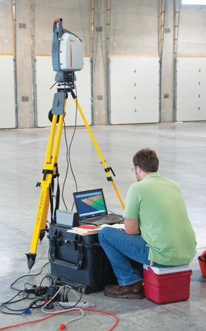 Brandon Elsbree uses a 3-D laser scanner and a computer to profile a section of the floor.