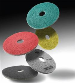 These Twister Pads developed by HTC are made by molding diamonds into the fibers of the pad. Each pad color denotes a different diamond grit rating. Workers use the pads for the final polishing steps and building owners maintain their floors with them afterward. Each time a floor is cleaned, the pads also polish the floors.