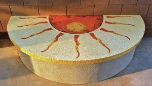 This sunburst design illustrates LuxeCrete Inc.'s full-depth concrete coloring technique.