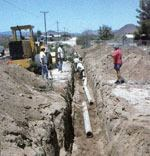 An asbestos cement pipeline was sheared due to a 5-foot horizontal offset at the fault line during the Landers, Calif., earthquake.