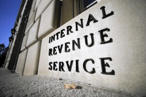 The Internal Revenue Service (IRS) building stands in Washington, D.C., U.S., on Tuesday, Nov. 13, 2012. President Barack Obama expressed confidence that he and Congress would reach an agreement that will avoid the automatic spending cuts and tax increases that are scheduled to occur at the end of the year. The fiscal cliff is the $607 billion combination of automatic spending cuts and tax increases scheduled to take effect in January. Lawmakers are trying to avert the cliff to prevent a short-term shock to the economy and reach an agreement on long-term deficit reduction. Photographer: Andrew Harrer/Bloomberg ** DP OUT, OS OUT, HOY OUT, TCN OUT **