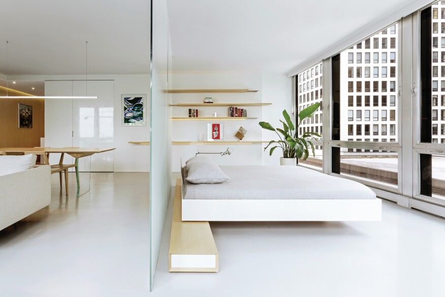In this renovation of Unit 3E in Chicago, local architecture firm Vladimir Radutny Architects used glass partitions and open shelving to keep this 750-square-foot unit feeling light and airy.