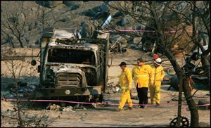 "FATAL TRAGEDY: Investigators examine a destroyed fire engine at the site of a deadly ""burnover"" near  Cabazon, Calif., where five Forest Service firefighters  died in a vain attempt to save one isolated house during the November 2006 Esperanza  fire."