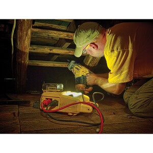 This DCL061 has a battery installed but is being run on AC power. The orange cord provides power to the light and to the recip saw that is plugged into it.