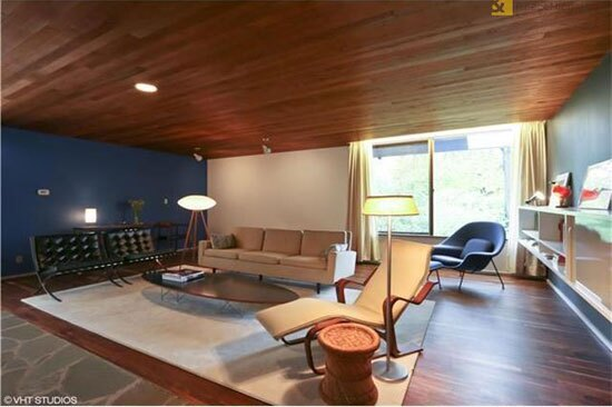 The current owners restored the living room's cedar-plank ceilings and kept much of Breuer's furnishings, including Mies' Barcelona Sofa (left.)