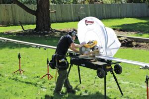 The optional chop-saw hood contains dust and can be used to help keep the saw dry in wet weather.