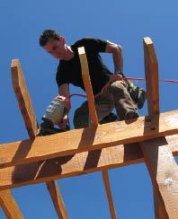 Toe-nails (or screws) fasten the rafters to the girders.