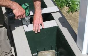 Figure 9. Screws hold down the surface facing, allowing it to be removed should the homeowners want to pull out the liners.