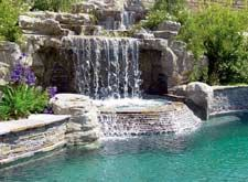The Canvas: Sparse suburban half-acre, the base of a mountain,unlimited possibilitiesThe Palette: Natural stone, forest shrubbery, rushing water, a private rock grottoThe Masterpiece: Sibilant swooshing sounds, aquatic acrobatics, enveloping rock formations