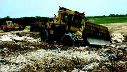 Because landfill space is at a premium, the publicly run Bees Ferry Landfill  in Charleston County, S.C., uses specialized equipment to mash the refuse  down. Photo: BOMAG
