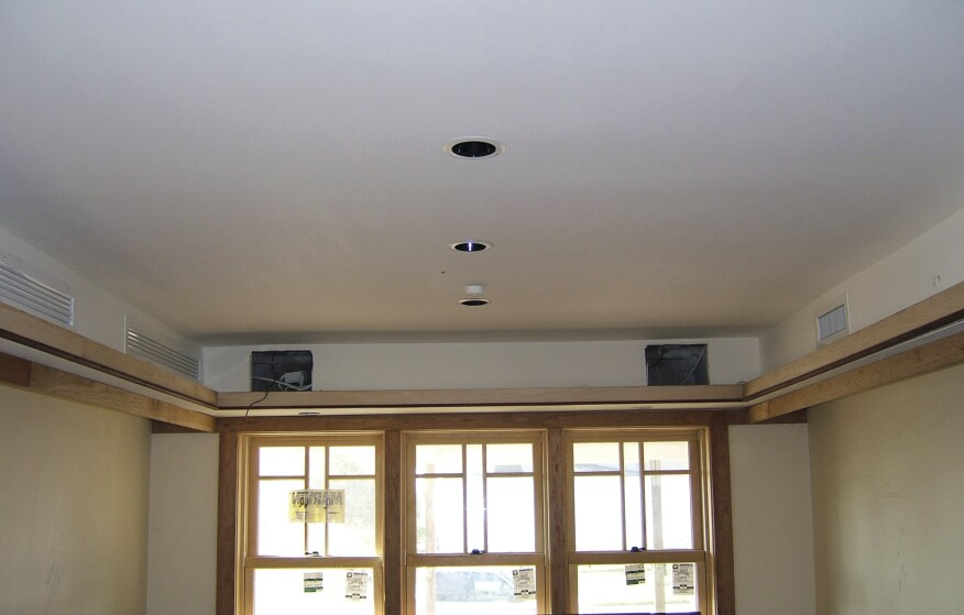 To reduce duct leakage to the outside, run ductwork inside conditioned space, through ceilings or (as shown here) through interior soffits. Photo: Clayton DeKorne