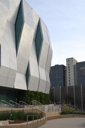 The faceted metal cladding allow natural light into the arena through vertical glazing and perforations.