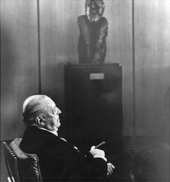 Mies van der Rohe in his Barcelona chair