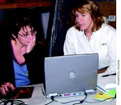 Denise Shelton, ToolWatch, demonstrates the database's capabilities to Anne Fitzpatrick, Emerald Construction, Richmond, Va., during a jump-start session.