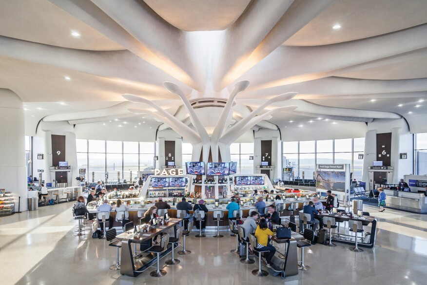 A view of the terminal at midday when the color temperature of the petal fixtures transitions to 4000K to balance the abundance of natural light.