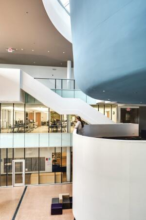 A three-story atrium surrounded by student spaces anchors the building.