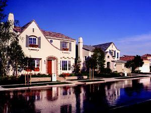 SWEET STREETS: By the late 1990s, neo-traditional planning was mainstream, but the idea of mixing housing styles along the same street was still a bit out there in the high-volume production realm. A groundbreaker of mass customization, Madison Lane (left) in Newport Beach, Calif., the 1998 Project of the Year, deftly creates community character out of diverse forms and a trio of lot sizes that enabled staggered setbacks and a staggering sales pace.