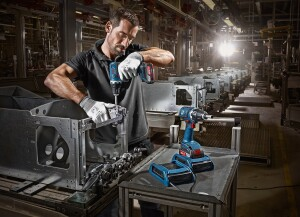 It makes sense that Bosch would show the battery and charger being used in a factory setting because the system is best suited to the tradesman who works from a fixed location and can place the tool on the charger after every use. This system would be equally appropriate for a cabinet shop or whenever tradesmen work at a bench.