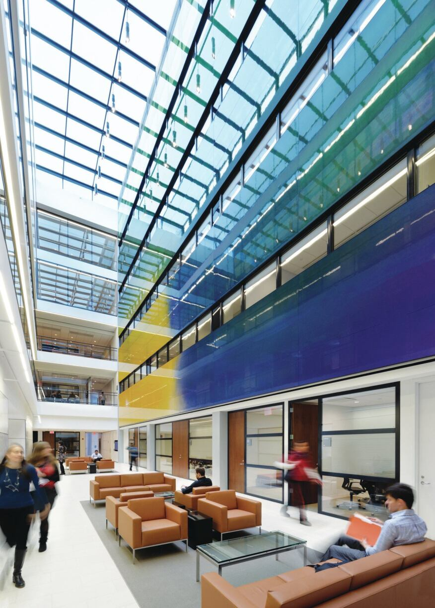 A triple-height atrium is programmed with lounge furniture to promote interaction between the students   and faculty.