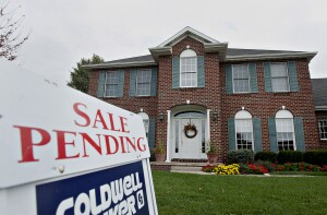 """A Coldwell Banker LLC """"Sale Pending"""" sign stands outside of a home in Peoria, Illinois, U.S., on Thursday, Oct. 18, 2012. The National Association of Realtors is scheduled to release existing homes data on Oct. 19. Photographer: Daniel Acker/Bloomberg via Getty Images"""