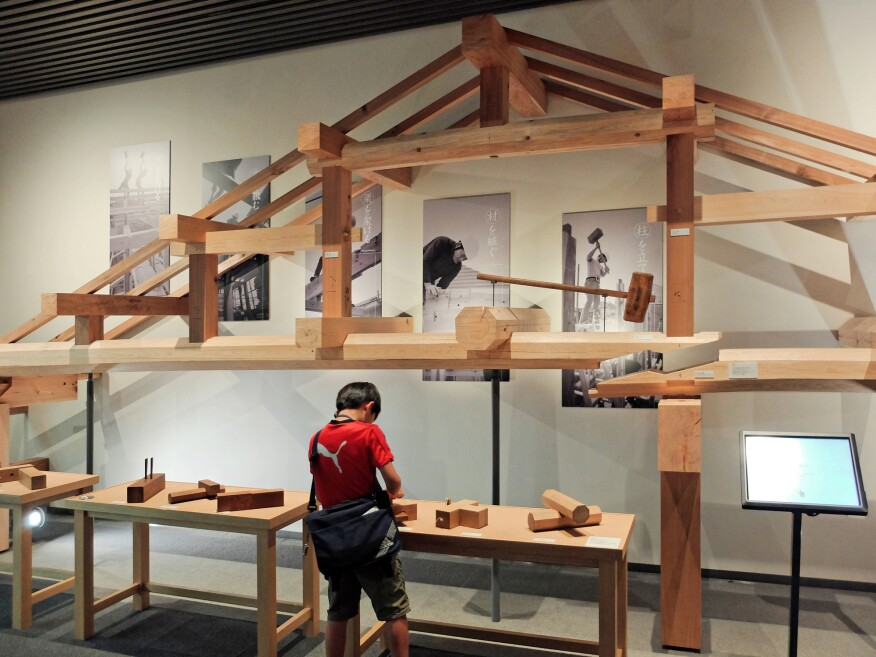 building japanese furniture. a partial model of building roof assembly revealing the sequential nature construction using japanese furniture