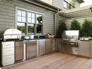 "The traditional ""work triangle"" can easily be applied to outdoor kitchens. Weathertight-stainless steel cabinetry keep utensils and all other kitchen gear handy and protected."