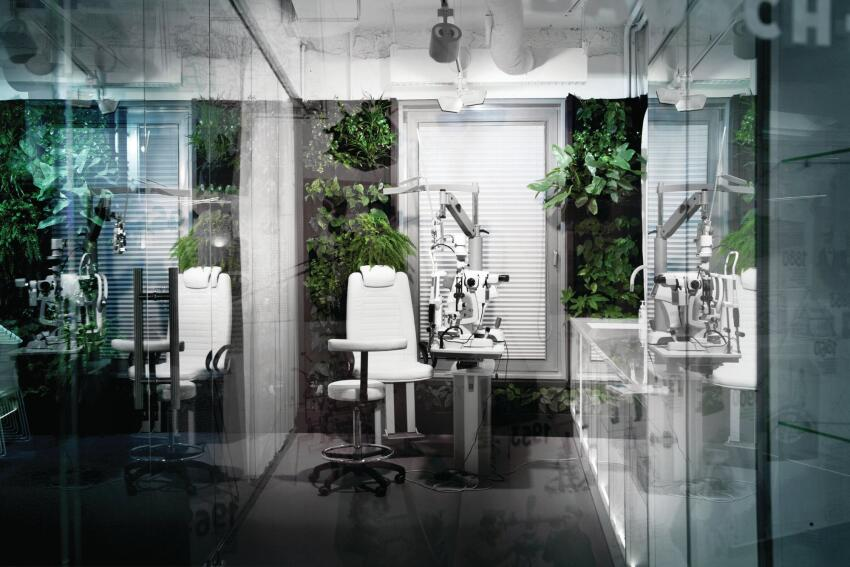 A green wall–lined exam room allows the staff to perform ophthalmological tests within the confines of their new office space.
