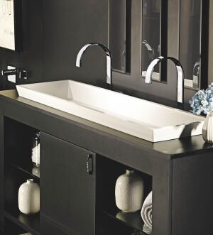 "The Petra Double Sink from MTI Whirlpools has a solid-surface construction and a minimalist design. A complement to the Petra Tub, the sink looks and feels like natural stone. Its surface is nonporous, so it is naturally resistant to stains and can be cleaned with nonabrasive household cleaners. It is made of MTIs Engineered Solid-Surface material, a mixture of ground minerals and binding agents that are liquefied, poured, and hardened. The sink measures 47-1/2"" long by 14"" wide by 5-1/8"" deep. It features one-piece construction and is available in white and biscuit in either a matte or gloss finish. Petra can be installed vessel-style on top of a vanity or ordered as a semi-recessed version. mtiwhirlpools.com"