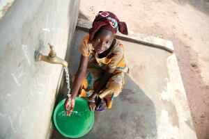Well off: Before World Vision worked in Kolda, Senegal, this girl and her family had to drink water that was only clean enough to wash pots and pans, and often they became ill. Now her village has one of the 8,700 wells built by World Vision that provides clean drinking water.