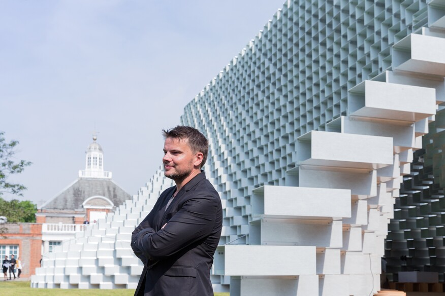 Bjarke Ingels stands in front of the Serpentine Gallery and the 2016 Serpentine Gallery Pavilion he and his firm, BIG, designed.