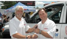 Sweepstakes winner Larry Allar (right) accepts the Site Commander keys from Tools of the Trade editor Rick Schwolsky.