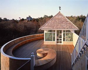 "WAVE LENGTH: Described as a ""trademark blend of elegance and whimsy,"" this vacation house (above) in Cape Cod, Mass., stretches along its oceanfront lot like a moored ship, a screened, detached ""bow house"" at one end, serviced by an expansive view deck with signature details that earned the house our 1992 Project of the Year award."