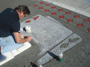 Jim Miller stains pervious concrete at the Pervious Concrete Live! event during World of Concrete earlier this year.