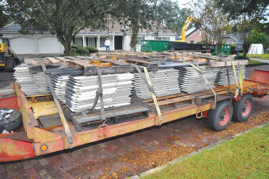 Step 2) Roof Reuse The flat concrete roof tiles from Johnson's home were carefully removed and stacked for transport. They now sit atop another Orlando, Fla., area home.