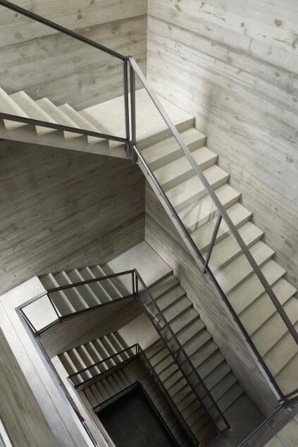 A skylit stairwell rises all five levels of the building.